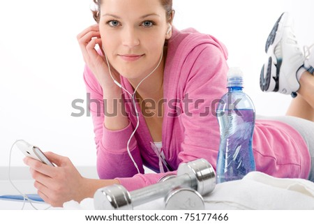 Fitness woman listen music mp3 relax gym on white background - stock photo