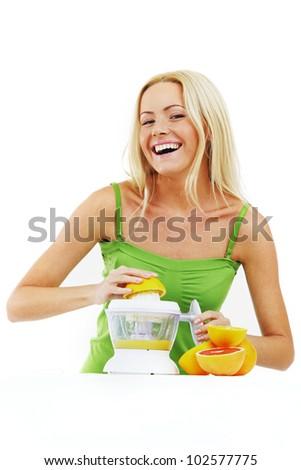 fitness woman make an orange juice - stock photo