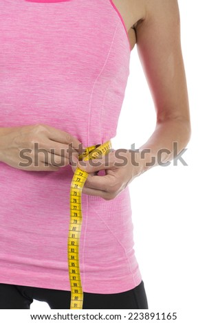 Fitness woman measuring her weight loss - stock photo