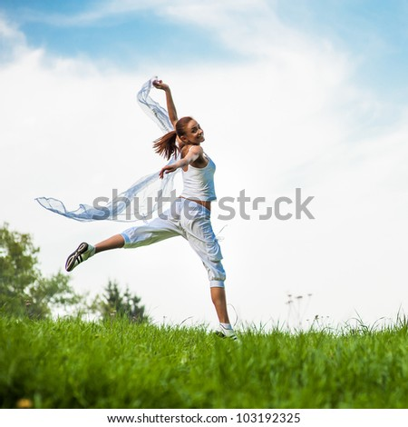 fitness woman on green park - stock photo