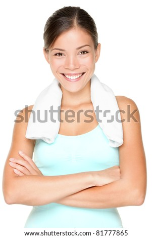 Fitness woman portrait isolated on white background. Smiling happy female fitness model looking at camera. Fresh beautiful multi-racial Caucasian Asian fitness girl. - stock photo