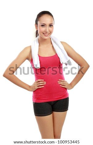 Fitness woman portrait looking at camera isolated on white background