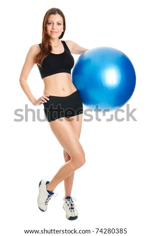Fitness woman posing with fitness ball - stock photo