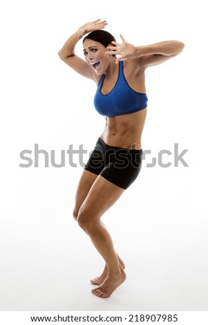 fitness woman protecting hes self with her arms above her head as if objects where falling from the sky - stock photo