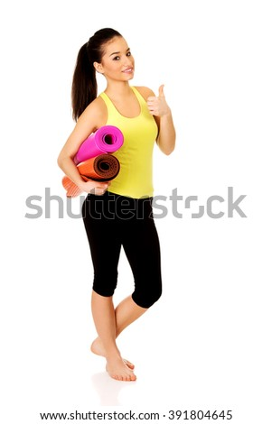 Fitness woman ready holding yoga mats. - stock photo