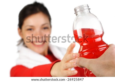 Fitness woman receiving an energy drink after workout. Isolated on white. - stock photo