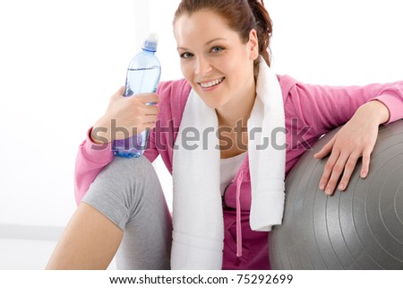 Fitness woman relax water bottle ball sportive outfit - stock photo