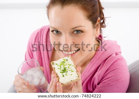 Fitness - woman relax with glass water snack on white - stock photo