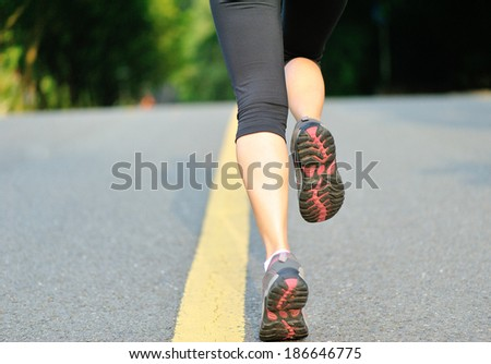 fitness woman running at road - stock photo