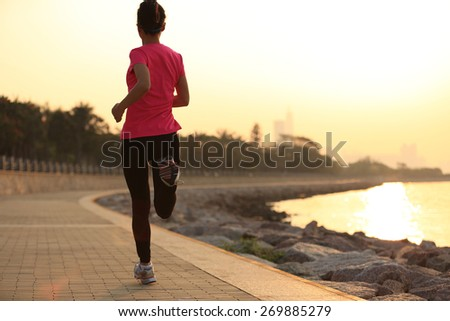 fitness woman running at seaside. woman fitness silhouette sunrise jogging workout wellness concept.