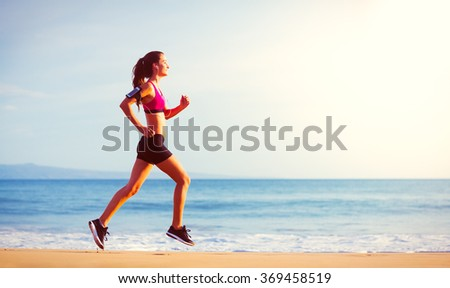 Fitness Woman Running by the Ocean at Sunset - stock photo