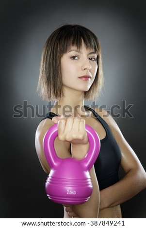 fitness woman shot in the working out using a kettlebell - stock photo
