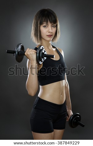 fitness woman shot in the working out using dumbbells
