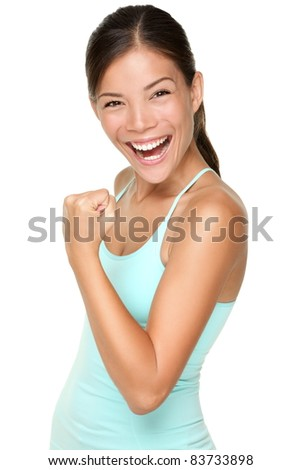 Fitness woman showing fresh energy flexing biceps muscles smiling happy isolated on white background. Beautiful fit mixed race Asian Caucasian female fitness model energetic and fun. - stock photo