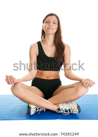 Fitness woman sitting in lotus yoga position. Isolated on white - stock photo