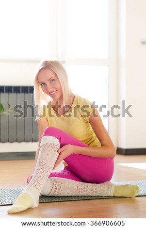 Fitness woman sitting on eco mat
