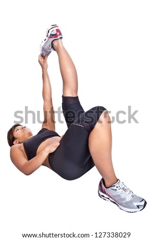 Fitness woman stretching hamstring while lying on floor - stock photo