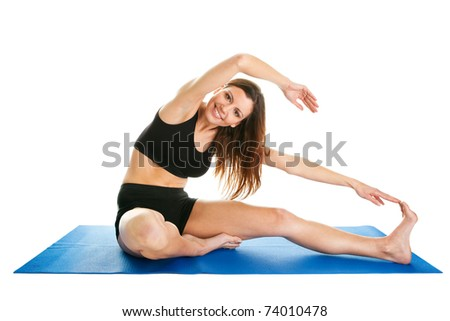 Fitness woman stretching on gym mat - stock photo