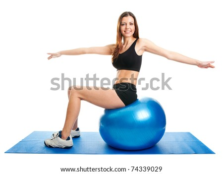 Fitness woman stretshing on fitness ball - stock photo