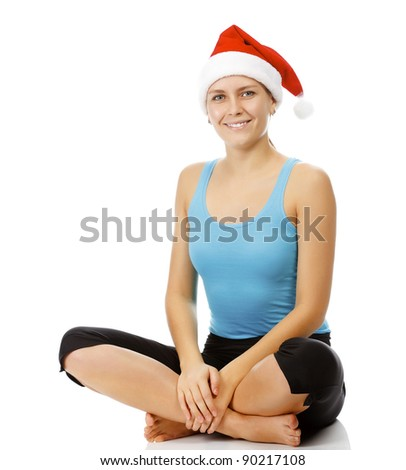Fitness woman wearing Santa's hat