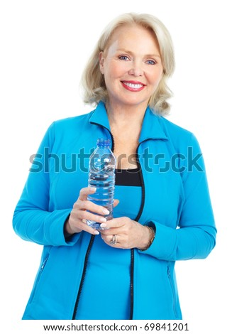 Fitness woman with a bottle of spring water