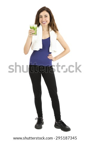 Fitness woman  with a glass of green smoothie, full length - stock photo