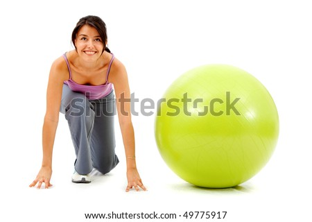 fitness woman with a pilates ball - ready to race isolated over a white background - stock photo