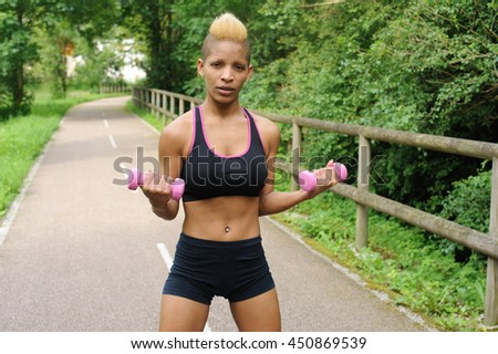 Fitness woman with dumbbells - stock photo