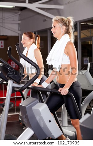 fitness women using stepper machine in gym - stock photo