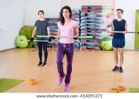 Fitness women  warming up, exercising doing workout in fitness club. - stock photo