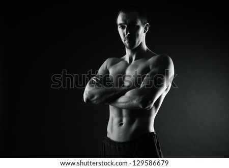 Fitness, young man crossed arms - stock photo