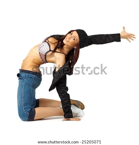 Fitness. Young woman dances against isolated white background