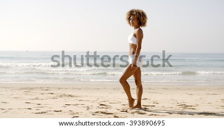 Fitness Young Woman Standing On Beach - stock photo