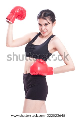 Fitness young woman with the red boxing gloves