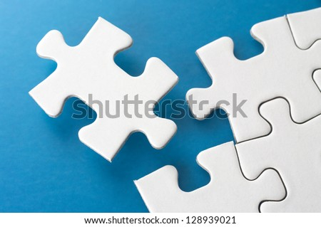 Fitting puzzle pieces.Concept image of building. - stock photo