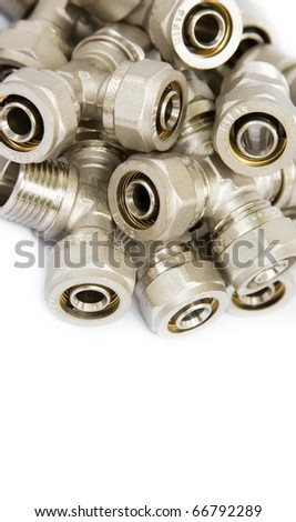 fittings for metal pipes on a white background - stock photo
