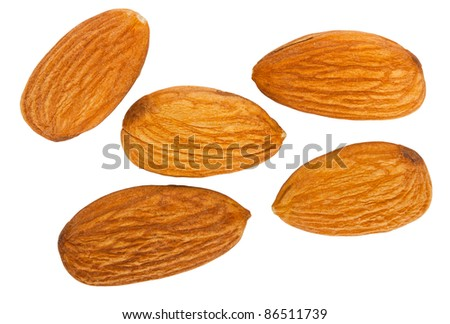 Five almond nuts isolated on white background - stock photo