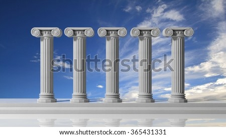 Five ancient pillars with blue sky background. - stock photo