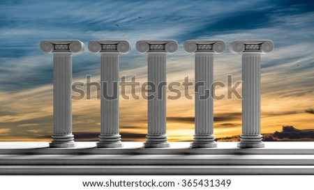 Five ancient pillars with sunset sky background. - stock photo
