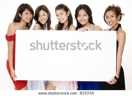 Five attractive asian women holding a big blank sign