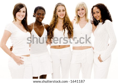 Five attractive women of mixed race in white on white - stock photo