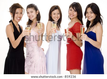 Five attractive young asian women in evening wear toast with champagne