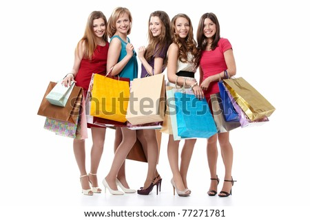 Five attractive young women with shopping on white background - stock photo