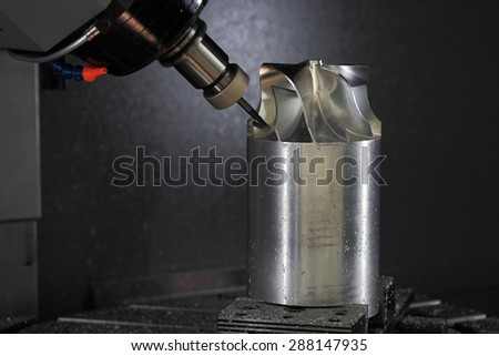 Five axis CNC machining center manufacturing jet engine turbine wheel. - stock photo