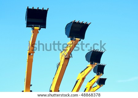 Five backhoe arms - stock photo