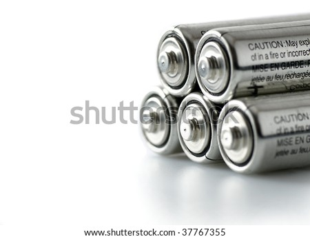 five batteries on white background - stock photo
