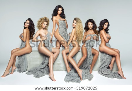 Five beautiful women on concrete block