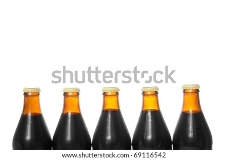 Five beer bottles isolated on a pure white background with blank copyspace above with room for your text. - stock photo