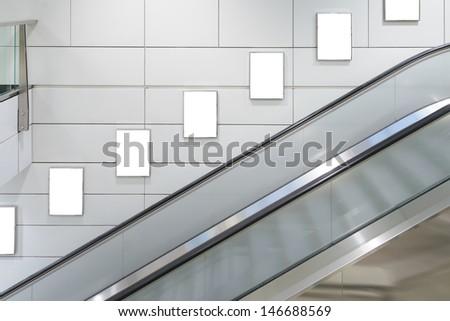 Five big vertical / portrait orientation blank billboard with escalator background - stock photo
