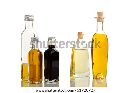 Five bottles of oil and vinegar in different outline and color - stock photo